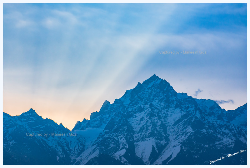 Sun about to rise. Kinner Kailash peak. Kinner Kailash Shivling can be seen in the 'V' on the left. Kalpa.