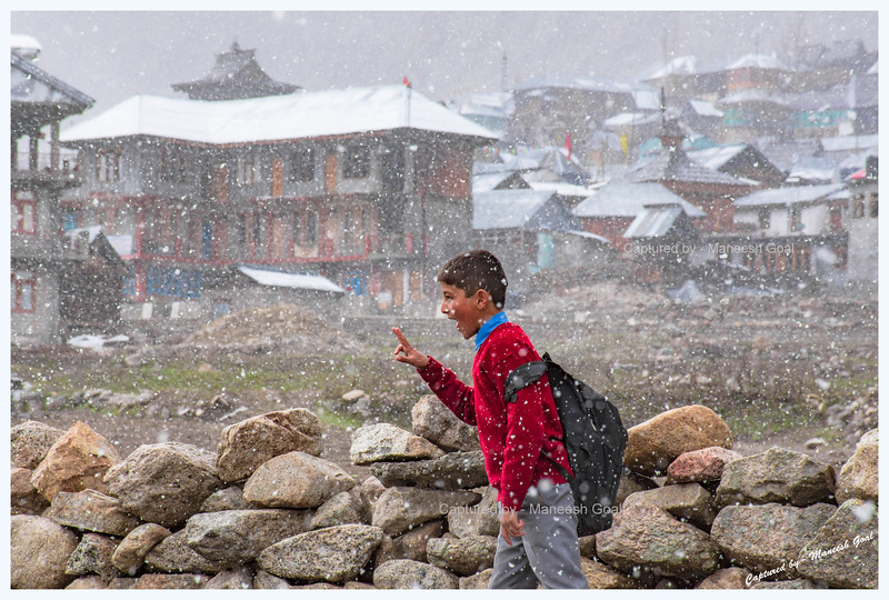 Kids walking back from school in the snowfall. Chitkul.