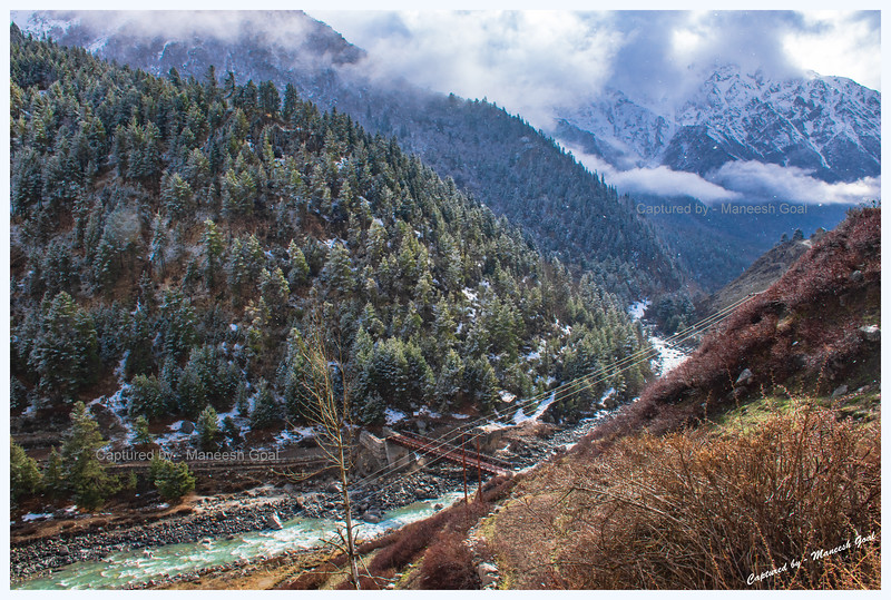 It stops snowing and the sun peeps out through a crack in the clouds. Chitkul. Baspa River