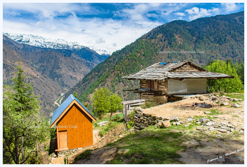 Traditional Himachali structure and a new log hut. Sainj Valley.