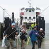 Ferry passengers disembark at Shapinsay Island Pier in Scotland, United Kingdom.