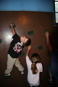 Tyler enjoying the rock climbing wall in the Peanut's Playhouse
