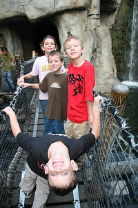 Tyler, Bryan, Ryan and Katie standing on the suspension bridge to one of the attractions