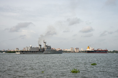 Indian Naval ships seen from Embarkation Jetty, at Kochi, Kerala, India. The jetty connects to Fort Kochi as well as Marine drive. Small non descript place which is peaceful. Boat ride costs just Rs 4 yes just four and frequency is about 15 min.