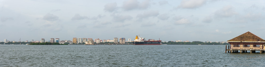 Panoramic view from Embarkation Jetty, at Kochi, Kerala, India connects to Fort Kochi as well as Marine drive. Small non descript place which is peaceful. Boat ride costs just Rs 4 yes just four and frequency is about 15 min.  The road just outside runs parallel to the water and nice to just watch the ships go by. So even if you don't want to take the boat a nice quiet location.