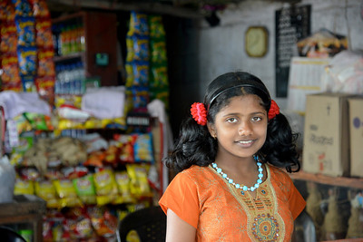Daughter of the food stall vendor. Enroute from Thekkady to Kochi in Kerala. Thekkady (Idukki district) in Kerala is the location of the Periyar National Park, which is an important tourist attraction in India. Thekkady sanctuary is located near the Kerala-Tamil Nadu state border and is famous for its dense evergreen, semi-evergreen, moist deciduous forests and savanna grass lands. It is home to herds of elephants, sambar, tigers, gaur, lion-tailed Macaques and Nilgiri Langurs.
