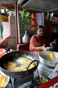 Food stalls make hot fried items enroute from Thekkady to Kochi in Kerala. Thekkady (Idukki district) in Kerala is the location of the Periyar National Park, which is an important tourist attraction in India. Thekkady sanctuary is located near the Kerala-Tamil Nadu state border and is famous for its dense evergreen, semi-evergreen, moist deciduous forests and savanna grass lands. It is home to herds of elephants, sambar, tigers, gaur, lion-tailed Macaques and Nilgiri Langurs.