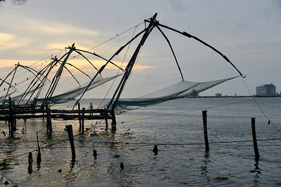 Traditional Chinese fishing nets are still in use in Kochi. Kochi earlier called Cochin, is a major port city on the west coast of India by the Arabian Sea and is part of the district of Ernakulam in the state of Kerala. Kochi is often called by the name Ernakulam, which refers to the mainland part of the city. Heralded as the Queen of the Arabian Sea, Kochi was an important spice trading centre on the Arabian Sea coast from the 14th century. Occupied by the Portuguese Empire in 1503, Kochi was the first of the European colonies in colonial India. It remained the main seat of Portuguese India until 1530, when Goa was chosen instead. The city was later occupied by the Dutch and the British, with the Kingdom of Cochin becoming a princely state.
