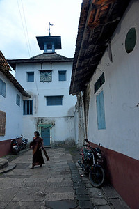 Jewish synagogue in Kochi, Kerala.  Kochi earlier called Cochin, is a major port city on the west coast of India by the Arabian Sea and is part of the district of Ernakulam in the state of Kerala. Kochi is often called by the name Ernakulam, which refers to the mainland part of the city. Heralded as the Queen of the Arabian Sea, Kochi was an important spice trading centre on the Arabian Sea coast from the 14th century. Occupied by the Portuguese Empire in 1503, Kochi was the first of the European colonies in colonial India. It remained the main seat of Portuguese India until 1530, when Goa was chosen instead. The city was later occupied by the Dutch and the British, with the Kingdom of Cochin becoming a princely state.