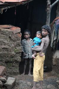 Children outside their very basic rural living conditions in this maharashtrian village enroute to Chinmaya Vibhooti, Kolwan, Maharashtra (MH), India