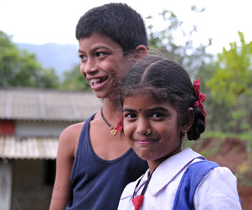 Young girl in school uniform with her playmates in Kolwan, Maharashtra (MH), India