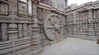 Short video clip of Konark Temple.   Konark Sun Temple in Orissa belongs to the Kalinga school of Indian temples and was constructed by King Narasimhadeva of the Eastern Ganga Dynasty in the 13th Century. This world heritage site temple takes the form of a colossal chariot of Surya (Sun) drawn by seven spirited horses on twelve pairs of exquitely decorated wheels. Surya has been a popular deity in India since the Vedic perios. Thousands of sculptured images depict deities, celestial and human musicians, dancers, lovers, and myriad scenes of courtly life, ranging from hunts and military battles to the pleasures of courtly relaxation. The temple is famous for its erotic stone sculptures, which can be found primarily on the second level of the porch structure.