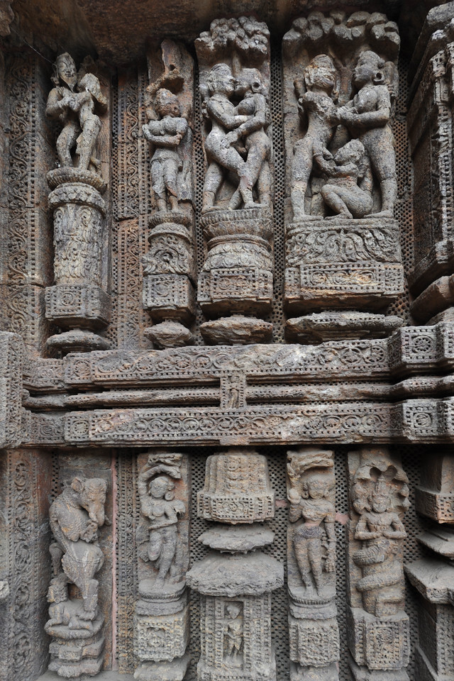 Various erotic and sexual visuals carved in stone.<br /> <br /> Konark Sun Temple in Orissa belongs to the Kalinga school of Indian temples and was constructed by King Narasimhadeva of the Eastern Ganga Dynasty in the 13th Century. This world heritage site temple takes the form of a colossal chariot of Surya (Sun) drawn by seven spirited horses on twelve pairs of exquitely decorated wheels. Surya has been a popular deity in India since the Vedic perios. Thousands of sculptured images depict deities, celestial and human musicians, dancers, lovers, and myriad scenes of courtly life, ranging from hunts and military battles to the pleasures of courtly relaxation. The temple is famous for its erotic stone sculptures, which can be found primarily on the second level of the porch structure.