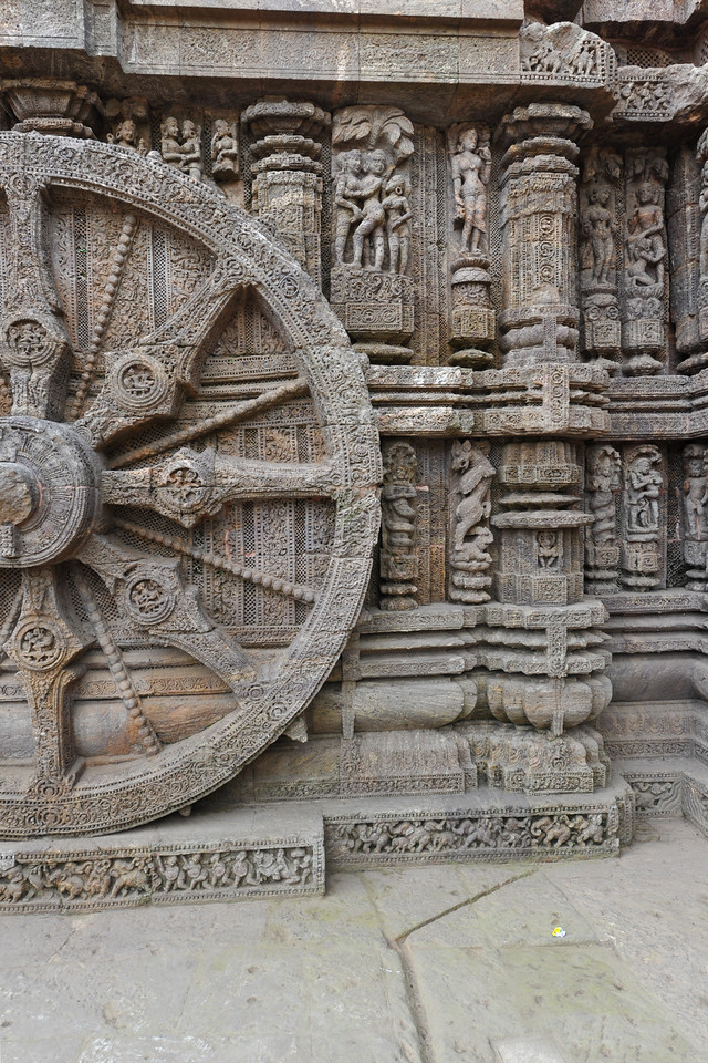 Detailed work done in stone depicting various sexual and erotic positions, carved on the massive stone wheels of Konark Sun Temple.<br /> <br /> Konark Sun Temple in Orissa belongs to the Kalinga school of Indian temples and was constructed by King Narasimhadeva of the Eastern Ganga Dynasty in the 13th Century. This world heritage site temple takes the form of a colossal chariot of Surya (Sun) drawn by seven spirited horses on twelve pairs of exquitely decorated wheels. Surya has been a popular deity in India since the Vedic perios. Thousands of sculptured images depict deities, celestial and human musicians, dancers, lovers, and myriad scenes of courtly life, ranging from hunts and military battles to the pleasures of courtly relaxation. The temple is famous for its erotic stone sculptures, which can be found primarily on the second level of the porch structure.