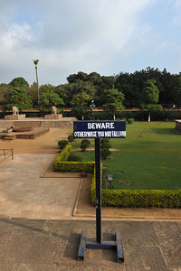 "Signboard ""BEWARE otherwise you may fall down"". The other pressumption being that only those who read English need to be stopped. Rest are smart?  Konark Sun Temple in Orissa belongs to the Kalinga school of Indian temples and was constructed by King Narasimhadeva of the Eastern Ganga Dynasty in the 13th Century. This world heritage site temple takes the form of a colossal chariot of Surya (Sun) drawn by seven spirited horses on twelve pairs of exquitely decorated wheels. Surya has been a popular deity in India since the Vedic perios. Thousands of sculptured images depict deities, celestial and human musicians, dancers, lovers, and myriad scenes of courtly life, ranging from hunts and military battles to the pleasures of courtly relaxation. The temple is famous for its erotic stone sculptures, which can be found primarily on the second level of the porch structure."