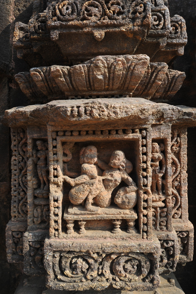 Making love - part of the temple has been lost in time but still the detailed carvings in stone are quite evident and there are efforts on restoration. Various erotic art forms were displayed along with various other images on the walls of the Sun Temple, Konark, Orissa.<br /> <br /> Konark Sun Temple in Orissa belongs to the Kalinga school of Indian temples and was constructed by King Narasimhadeva of the Eastern Ganga Dynasty in the 13th Century. This world heritage site temple takes the form of a colossal chariot of Surya (Sun) drawn by seven spirited horses on twelve pairs of exquitely decorated wheels. Surya has been a popular deity in India since the Vedic perios. Thousands of sculptured images depict deities, celestial and human musicians, dancers, lovers, and myriad scenes of courtly life, ranging from hunts and military battles to the pleasures of courtly relaxation. The temple is famous for its erotic stone sculptures, which can be found primarily on the second level of the porch structure.