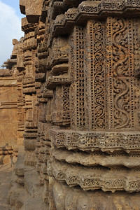 Exquisite details in stone sculptures at Konark Temple.  Konark Sun Temple in Orissa belongs to the Kalinga school of Indian temples and was constructed by King Narasimhadeva of the Eastern Ganga Dynasty in the 13th Century. This world heritage site temple takes the form of a colossal chariot of Surya (Sun) drawn by seven spirited horses on twelve pairs of exquitely decorated wheels. Surya has been a popular deity in India since the Vedic perios. Thousands of sculptured images depict deities, celestial and human musicians, dancers, lovers, and myriad scenes of courtly life, ranging from hunts and military battles to the pleasures of courtly relaxation. The temple is famous for its erotic stone sculptures, which can be found primarily on the second level of the porch structure.