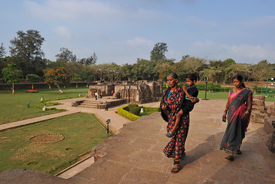 Many visitors come to see the Konark Temple.  Konark Sun Temple in Orissa belongs to the Kalinga school of Indian temples and was constructed by King Narasimhadeva of the Eastern Ganga Dynasty in the 13th Century. This world heritage site temple takes the form of a colossal chariot of Surya (Sun) drawn by seven spirited horses on twelve pairs of exquitely decorated wheels. Surya has been a popular deity in India since the Vedic perios. Thousands of sculptured images depict deities, celestial and human musicians, dancers, lovers, and myriad scenes of courtly life, ranging from hunts and military battles to the pleasures of courtly relaxation. The temple is famous for its erotic stone sculptures, which can be found primarily on the second level of the porch structure.