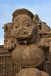 The entrance to Konark Temple is guarded by two giant lions, which are each shown crushing a war elephant which in turn lies on top of a human body. At the entrance of the temple is a Nata Mandir. This is where the temple dancers used to perform dances in homage to the Sun god. The temple symbolizes the majestic stride of the Sun god.   Konark Sun Temple in Orissa belongs to the Kalinga school of Indian temples and was constructed by King Narasimhadeva of the Eastern Ganga Dynasty in the 13th Century. This world heritage site temple takes the form of a colossal chariot of Surya (Sun) drawn by seven spirited horses on twelve pairs of exquitely decorated wheels. Surya has been a popular deity in India since the Vedic perios. Thousands of sculptured images depict deities, celestial and human musicians, dancers, lovers, and myriad scenes of courtly life, ranging from hunts and military battles to the pleasures of courtly relaxation. The temple is famous for its erotic stone sculptures, which can be found primarily on the second level of the porch structure.
