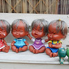Dolls in various moods outside a fortune teller's shop