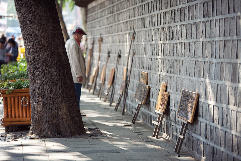 Along the old wall were artists selling wares. And the people interested in them.
