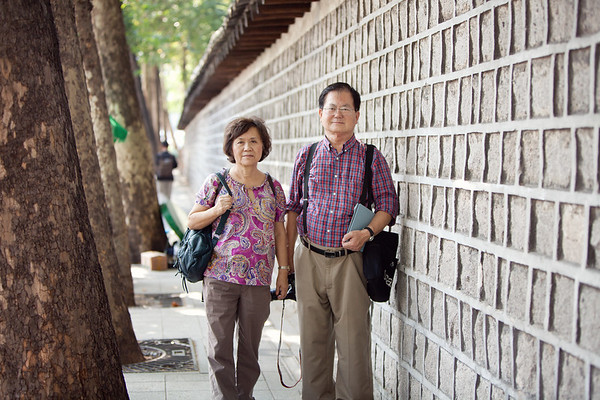 Mom and dad along the wall that they have so many memories of.