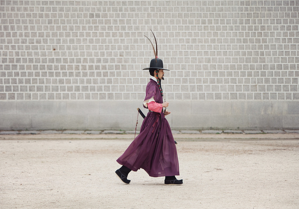 The reenactors walk out for the daily changing of the guard at Gyeongbokgung.