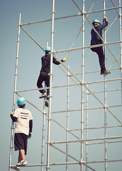 Workers assembling the scaffolding for the Arirang Festival that would happen that weekend.