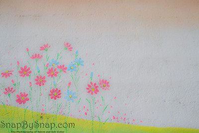 Bright spring flowers painted onto a concrete