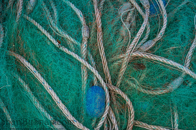 Abstract nautical image of a pile of old blue fishing net