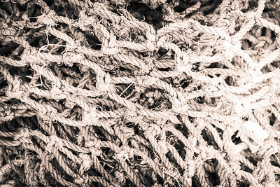 Black and white image of a pile of old fishing net