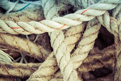 Nautical background of old frayed boat rope