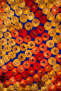 Rows and rows of colorful illuminated buddhist lotus lanterns