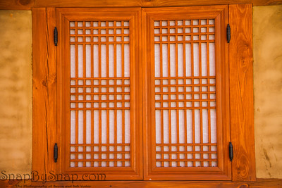 Korean style traditional wooden window with closed laced shutter