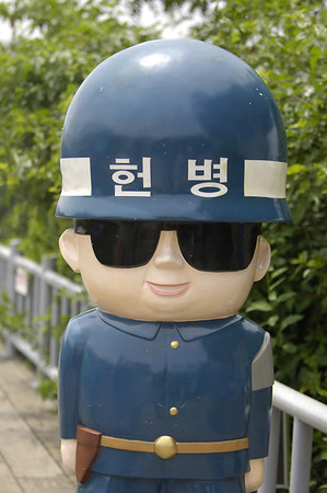 "Joint Security Area - Panmunjom: Character dressed as a South Korean Guard. Helmet translates into ""Military Police"" in Korean."