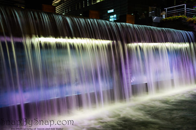 A waterfall flowing at night