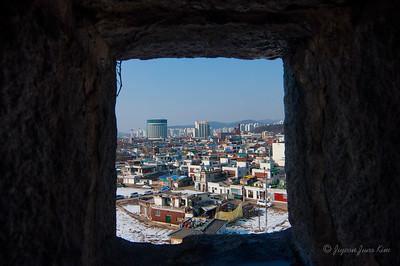 Suwon city through the archery hole
