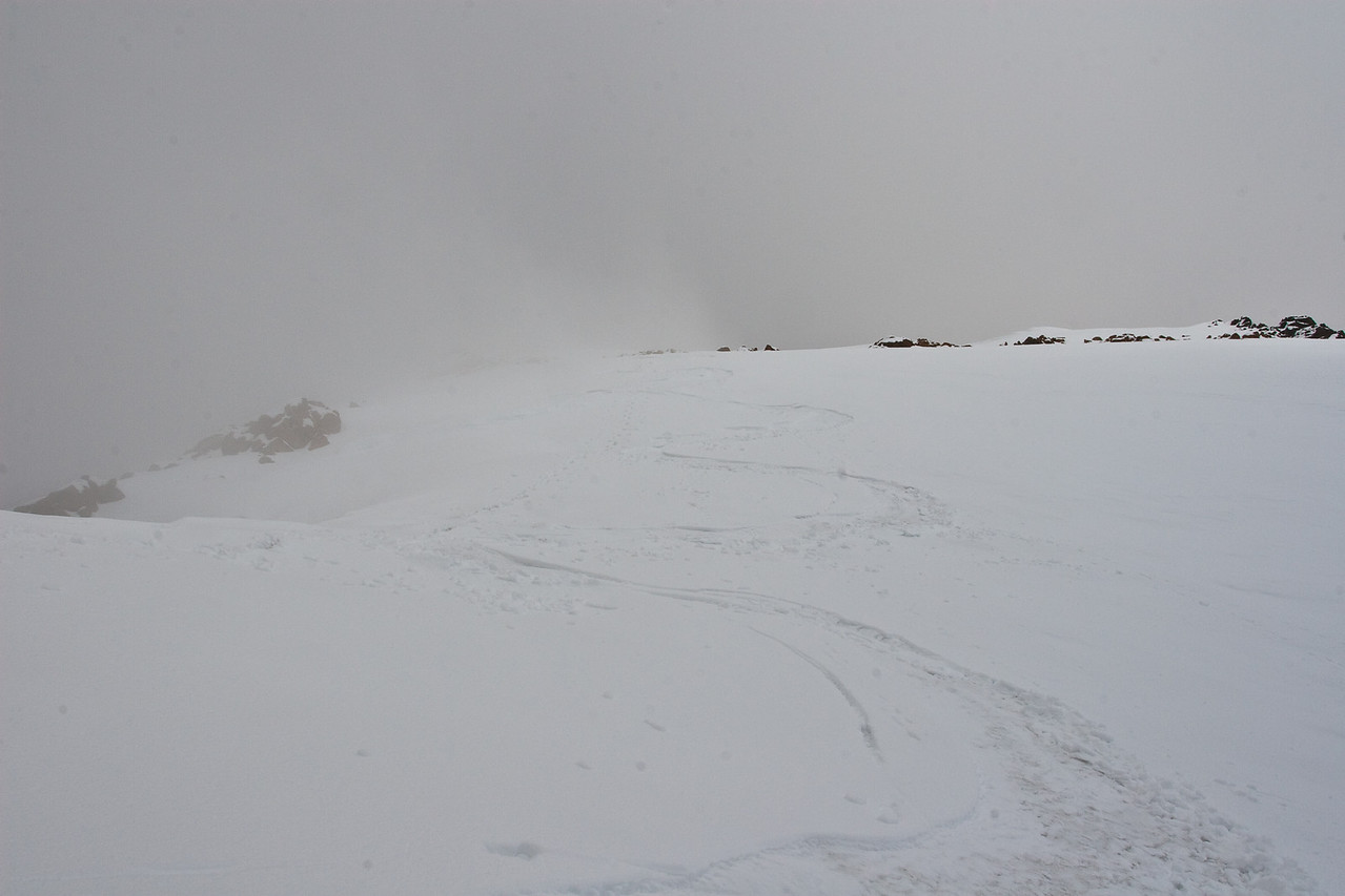 Skiing from the top, note the ash layer from the Mount Redoubt eruptions exposed in the turns.