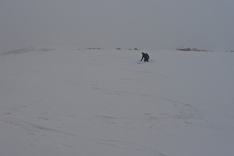 Gretchen skiing down.