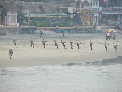 Fishermen pulling a boat