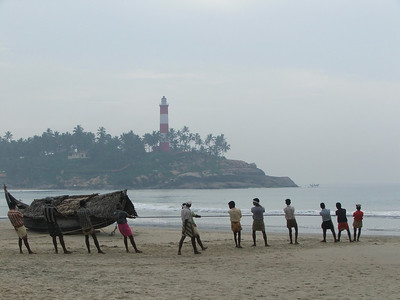 Fishermen pulling a boat onshore