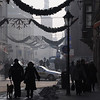Krakow, Poland - Christmas decorations on busy snowy street