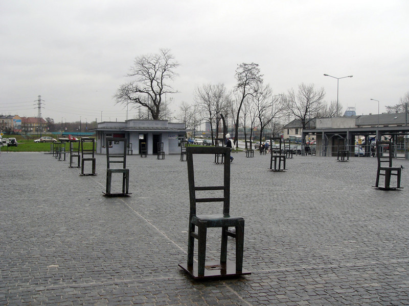 On relocation, many chairs were left in the square.  As a memorial, sculpted chairs dot the square.
