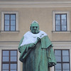 Krakow, Poland - snow-covered statue on Swietych Square