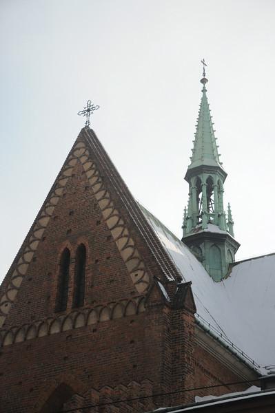Krakow, Poland - Franciscan church steeple, snow on roof