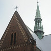 Krakow, Poland - Franciscan church steeple, snow on roof