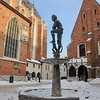 Krakow, Poland - statue of young Turk in St. Mary's Square next to the Basilica - just off Main Market Square (Rynek Glówny) - in snow - St. Barbara's church on right