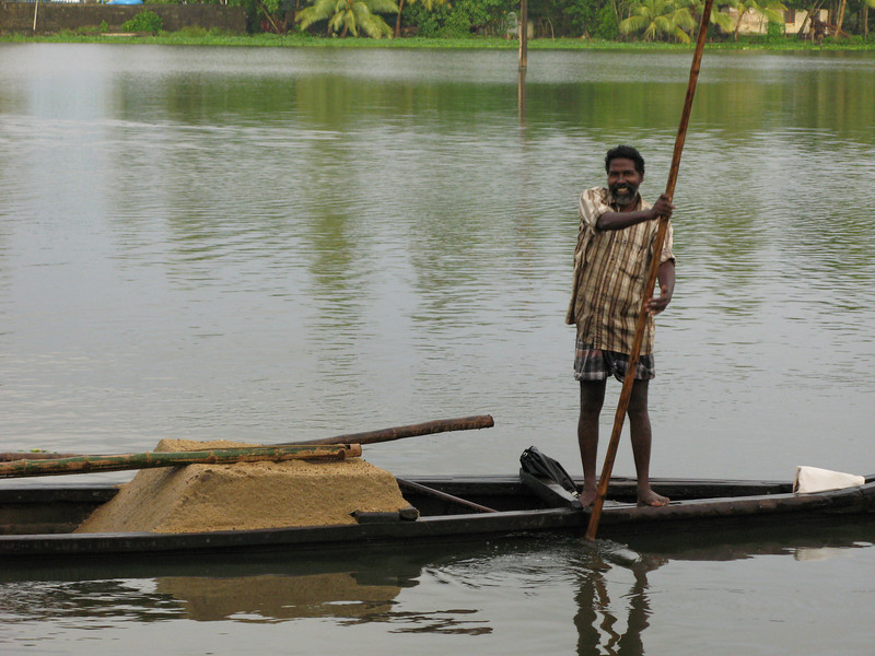Fisherman transporting sand.