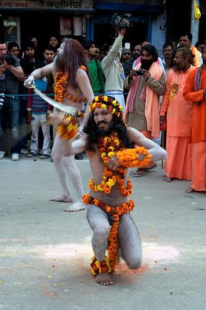 Sword wielding Naga Babas during the procession of the Niranjani akhara. Kumbh Mela 2010, Haridwar.