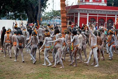 Naga Baba circling the flag. Kumbh Mela 2010, Haridwar.